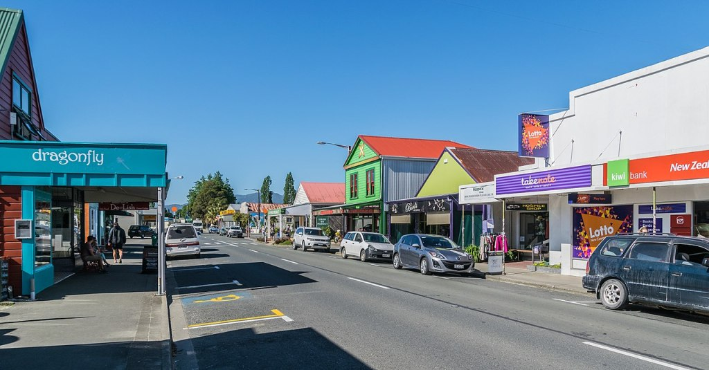 A colorful main street in Golden Bay.