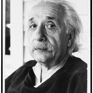 A black-and-white head-and-shoulders portrait of Albert Einstein in old age.