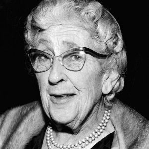 A black-and-white head-and-shoulders portrait of Agatha Christie in old age.