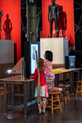Two children interacting with a touch-screen installation in the Gender Blender exhibition.