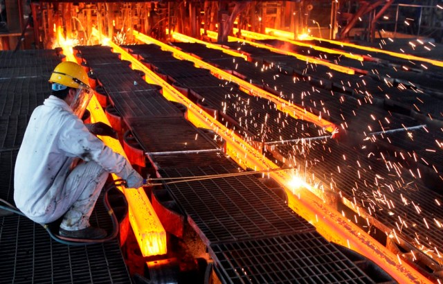 A worker cut steel bars at a steel plant in Ganyu, Jiangsu province June 9, 2014. China's consumer inflation edged up to a four-month high of 2.5 percent in May while factory price deflation eased, reinforcing signs of stabilization in the economy. Picture taken June 9, 2014. REUTERS/China Daily (CHINA - Tags: BUSINESS) CHINA OUT. NO COMMERCIAL OR EDITORIAL SALES IN CHINA - RTR3SZM2