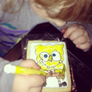 Averie coloring a spongebob cookie I drew up for her