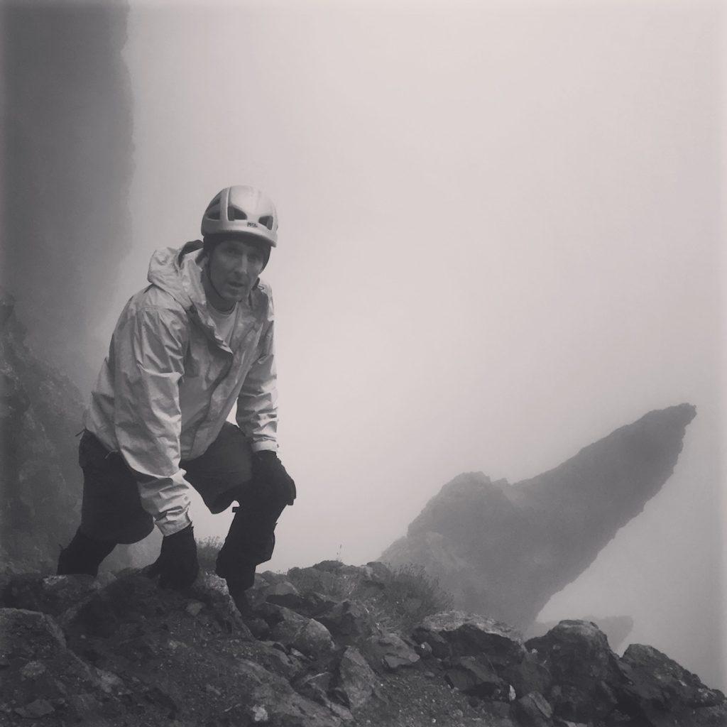 Ray Cameron on Crestone Peak ascending Broken Hand Pass in weather