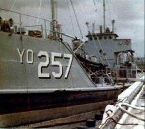 YO-257_at_dock_Fred_Robson