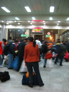 People Waiting to Board Buses