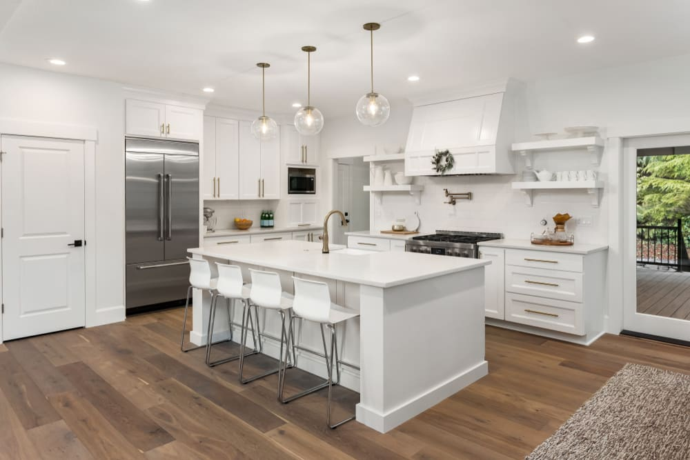 white kitchen with white furniture - 4 questions to ask before your next renovation