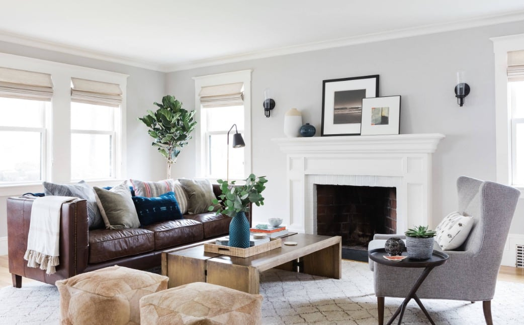 white fireplace with two pictures on top - The 4 most common mistakes in the living room and tips to correct them
