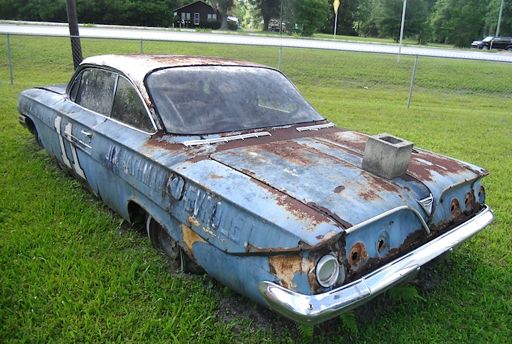 Abandoned A C   Abandoned Cars and Trucks CHEVROLET  1961  This 1961 Chevrolet Impala bears the inscription  Jim  Rathman Chevrolet  with the number 11  Rathman was a well known race car  driver and