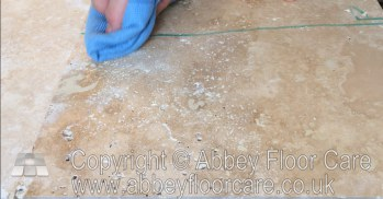 wipe away excess travertine filler