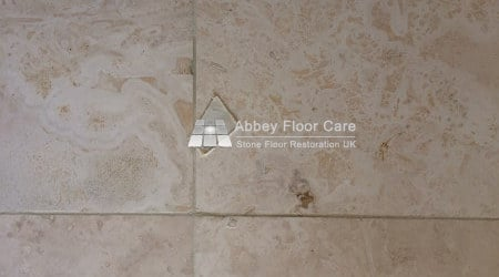 travertine tiles in balderton newark filled with hard filler