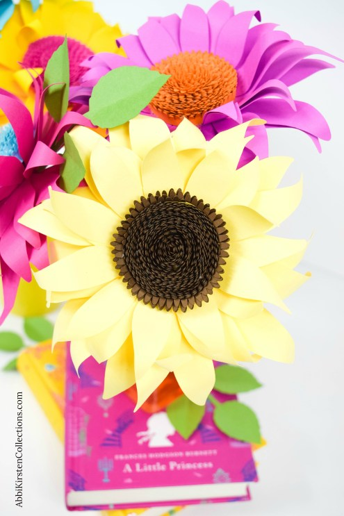 Paper Sunflower Tutorial: How to Make Classic Paper Sunflowers. Follow this easy paper flower tutorial to learn how and make beautiful paper sunflowers.