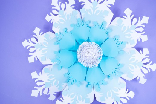 Create your own easy giant paper snowflakes with our paper snowflake tutorial and template. Deck your halls for Christmas with these big paper snowflakes.