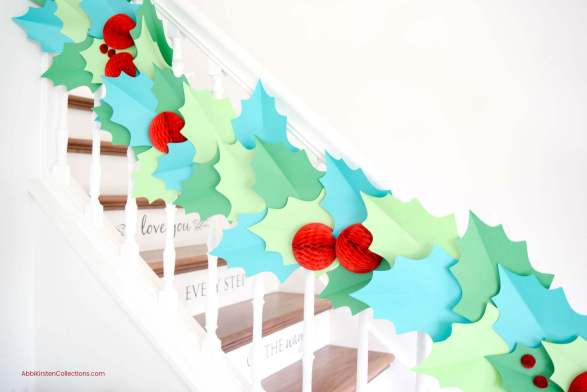 DIY Christmas Garland - How to Make Giant Paper Holly Garland to deck your halls and walls for the Holidays. Download your free holly template!