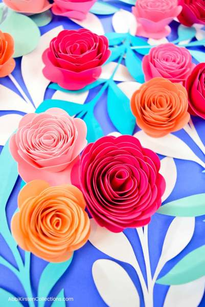 How to make paper rosette flowers. Free paper flower tutorial. SVG cut file and PDF printables.