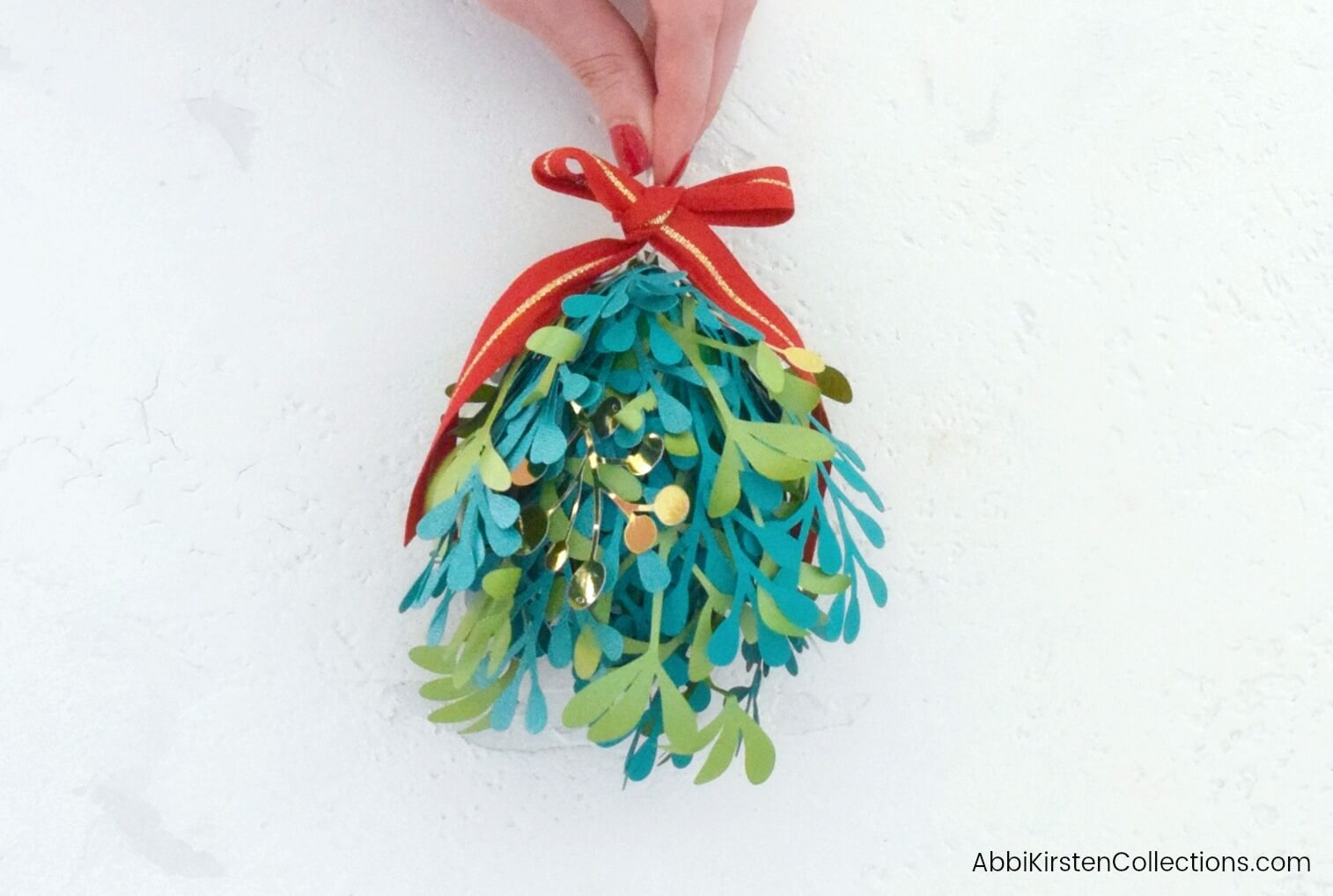 DIY Paper Mistletoe: Deck the Halls with Christmas Kissing Balls