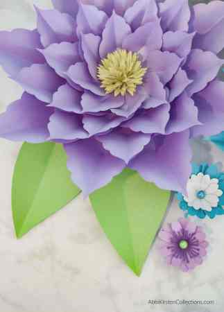 Large purple paper flowers for backdrops and party decor.