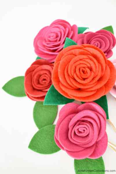 Felt roses with this easy felt flower tutorial and free SVG cut for your Cricut or PDF printables with a pair of scissors.