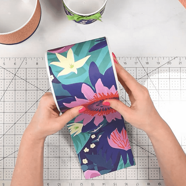 Cover vases with patterned wrapping paper.