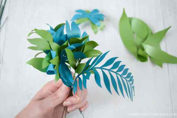 Making paper vines and leaves.