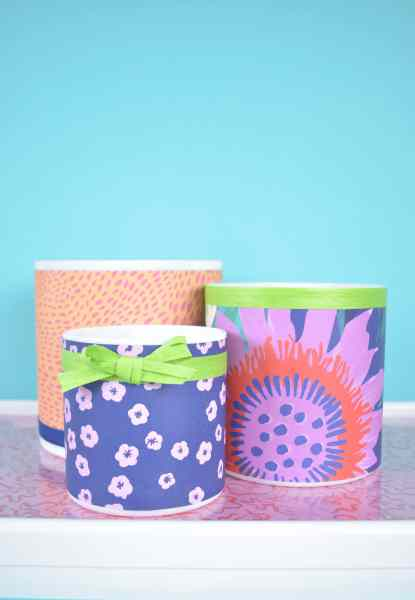 Cover cylinder vases with wrapping paper.