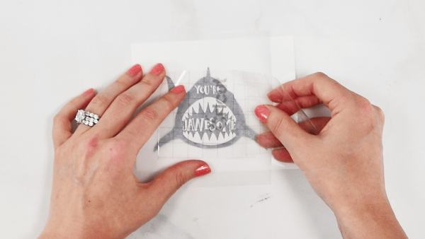 Use parchment paper to layer vinyl and aligned it correctly.