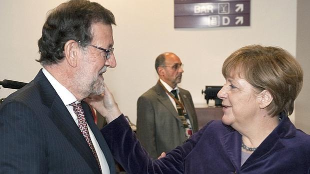 Rajoy, ayer junto a Merkel en Bruselas