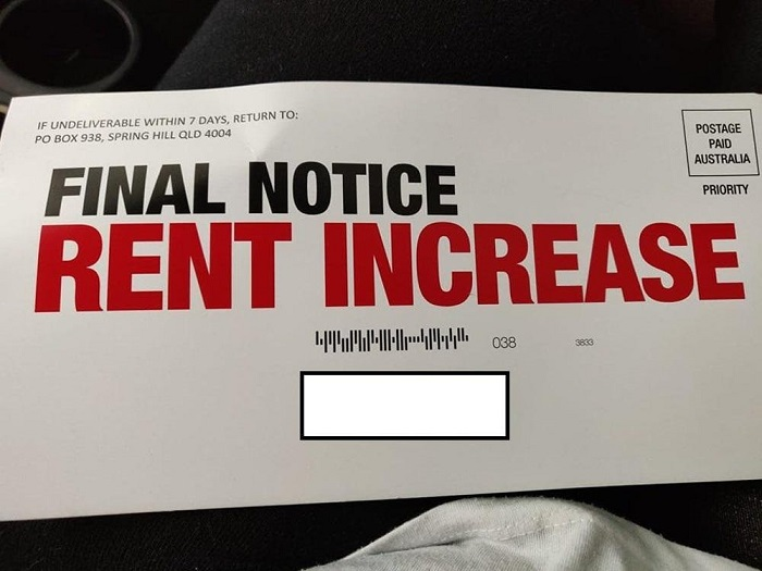 "An envelope that reads ""final notice, rent increase"" in huge red lettering"