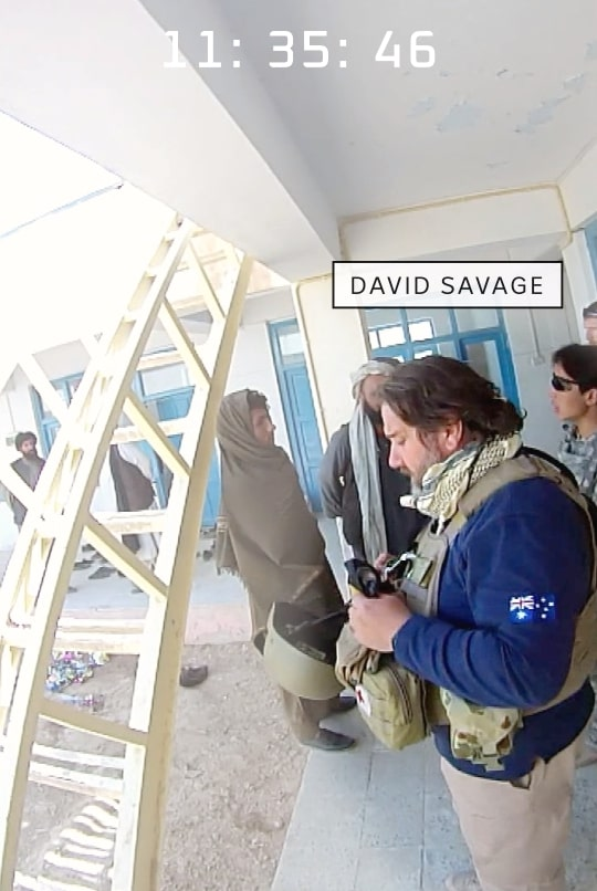 David Savage with soldiers at the compound.