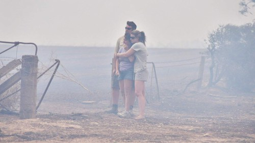 Wasleys residents look at the ruins of their house, which was destroyed in a Bushfire.