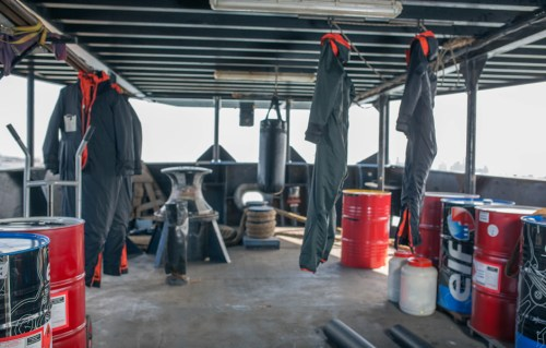Cold weather suits and punching bags hang on deck