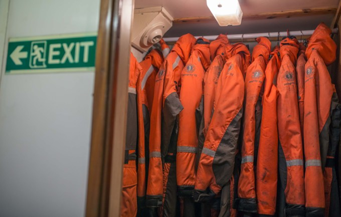 Cold weather deckhand suits hand in closet