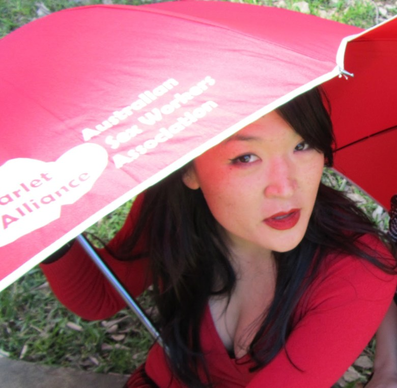 A woman with a red umbrella.
