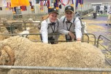 Two young women with a ram at the Sydney Royal Show