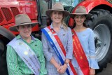 Three young woman wearing their Showgirls sashes at the Royal Easter Show
