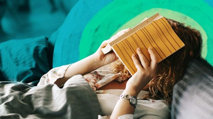 Women in bed with a book on their face to tell if you are too sick to go to work