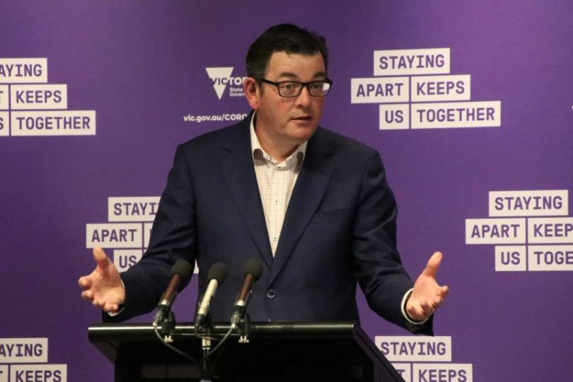 Victorian Premier Daniel Andrews at a press conference on Friday, September 11, speaking at a podium with a purple backgound.
