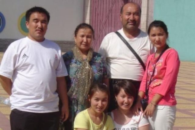 FatimahAbdulghafurpictured with her family at a Beijing Amusement Park in 2008.
