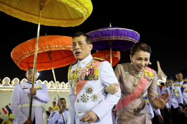 Thailand's King Maha Vajiralongkorn and Queen Suthida greet their royalists as they leave a religious ceremony in Bangkok.