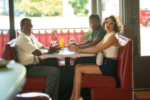 Actors Courtney B. Vance, Jurnee Smollett and Jonathan Majors in a diner in 50s America in TV show Lovecraft Country