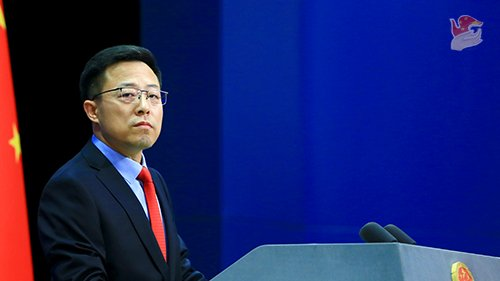 Chinese Ministry of Foreign Affairs spokesman Zhao Lijian stands at a lectern