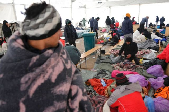 Migrants sit in a temporary shelter at the Lipa camp north-western Bosnia.