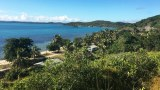 The view from St Joseph's Church reveals palm-fringed beaches, turquoise water, reefs and a glimpse of nearby Thursday Island