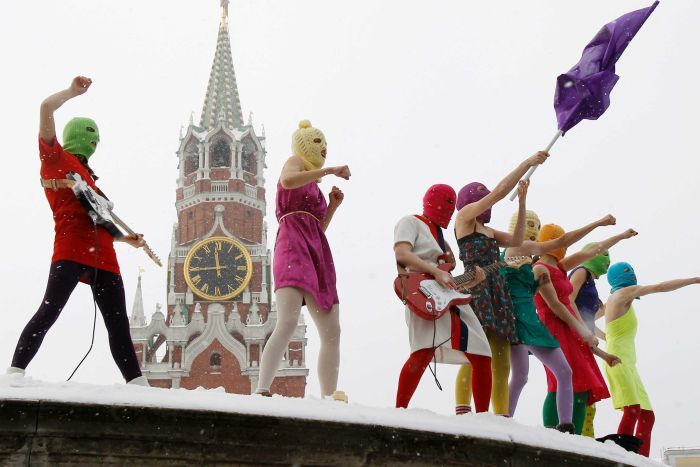 Members of the Russian radical feminist group 'Pussy Riot' sing in the Red Square