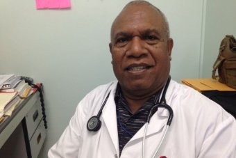 Dr Polapoi Chalau is sitting in his clinic.