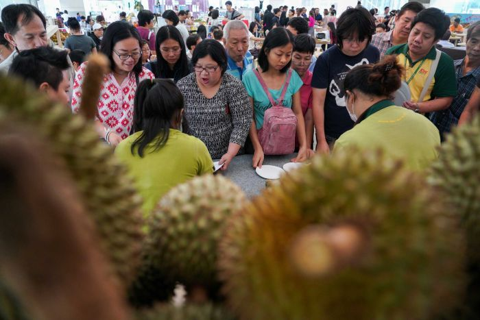 People queue for durians