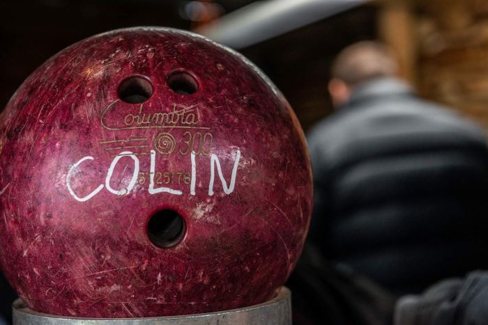A bowling ball bearing the name 'Colin'.