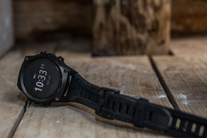 Diver's wrist watch shows the time.