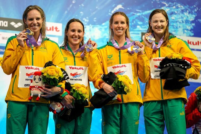 Emily Seebohm, Jessica Hansen, Emma McKeon and Cate Campbell hold up medals.