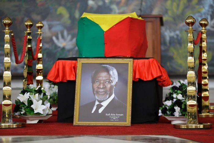 A portrait of former UN Secretary-General Kofi Annan rests on his coffin draped with a flag.