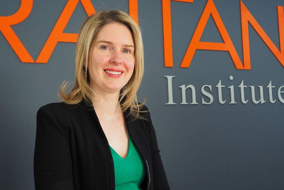 Danielle Wood stands in front of the Grattan Institute sign.